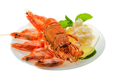 Spiny lobster, shrimps and rice Stock Photo