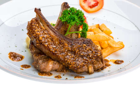 Lamb chops with fried potato photo