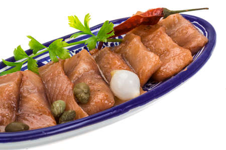 Sliced herring in paprica sauce photo