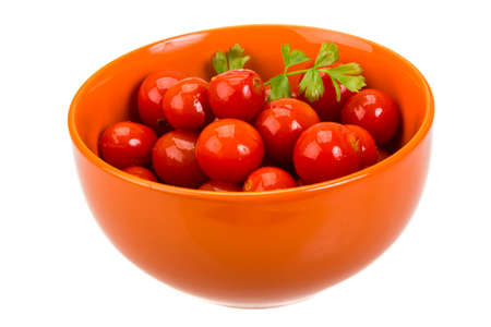 Marinated cherry tomato with herbs photo