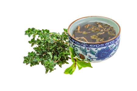 Tea with thyme and mint isolated photo