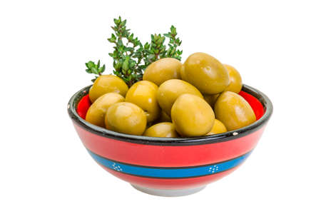 Green gigant olives with thyme photo