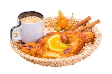 Coffee with bun and cinnamon photo