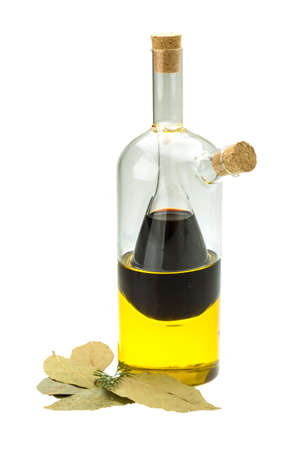 Vinegar, olive oil and laurel isolated on white photo