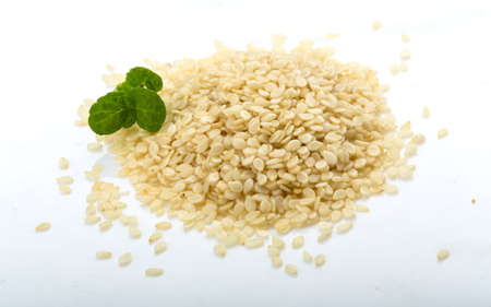 white sesame seeds: White sesame seeds with mint leaves