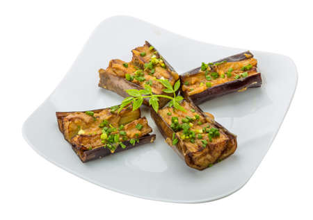 Grilled eggplant with onion and souce photo