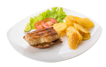 Grilled pork with potato chips photo