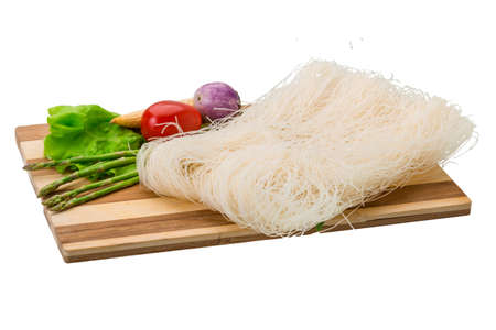 Raw rice noodles with asparagus and vegetables photo