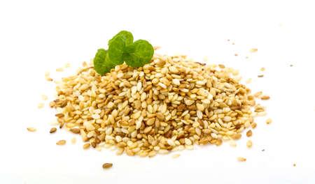 roasted sesame: Roasted sesame seeds heap isolated