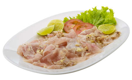Swordfish carpaccio with lime and salad leaves photo