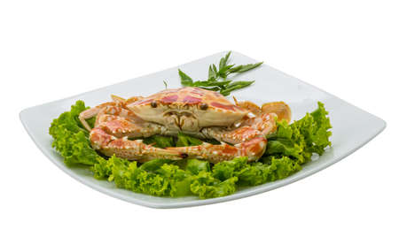 Boiled crab with salad leaves photo