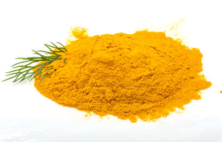 Curcuma powder isolated with dill photo
