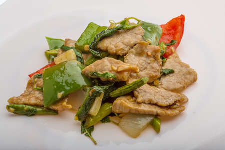 Thai cuisine - Pork with vegetables photo