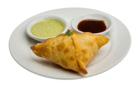 chutney: Samosa - indian empanadas tradicionales Foto de archivo