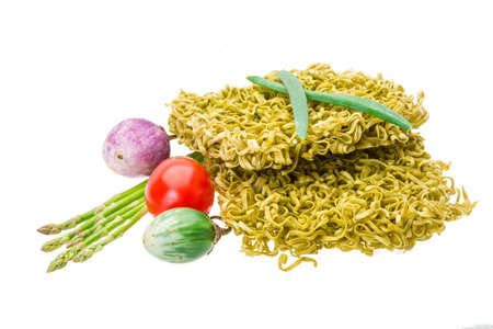 Green raw noodles with asparagus and vegetables photo