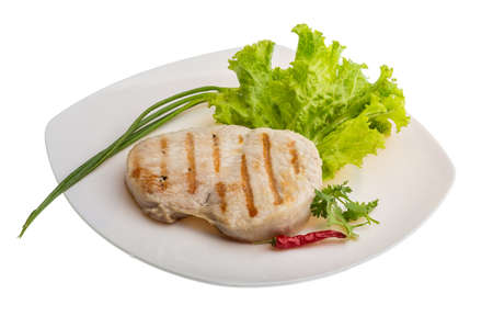 Pork steak grilled with salad and onion photo