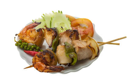 Seafood barbeque - shrimp, calamari, tuna photo