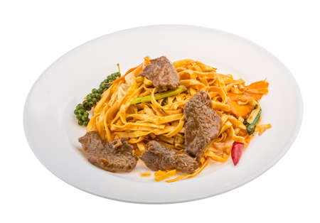 Fried noodles with beef and vegetables photo
