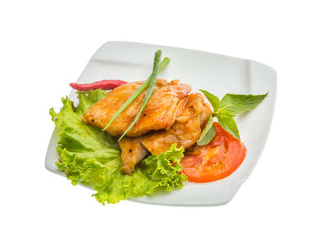 Baracuda steak with sauce and salad photo