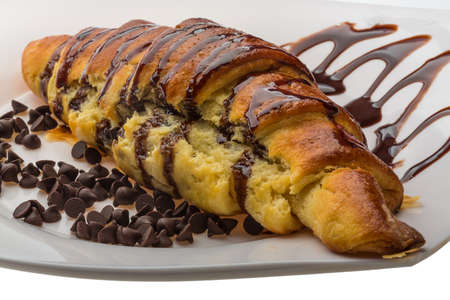 Fresh Croissant with chocolate topping photo