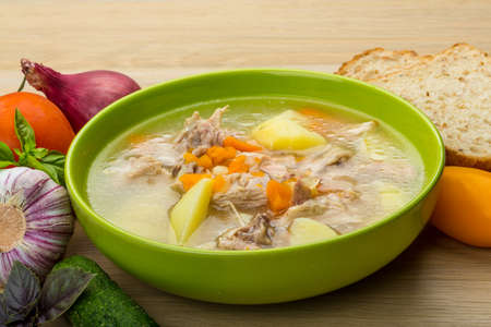 Chicken soup with vegetables and basil Stock Photo