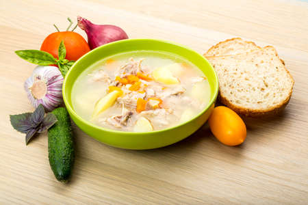 Chicken soup with vegetables and basil photo