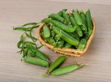 Fresh green peas in the bowl photo
