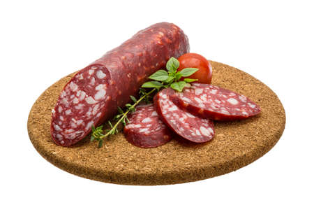 Salami sausages sliced with basil and tomato photo