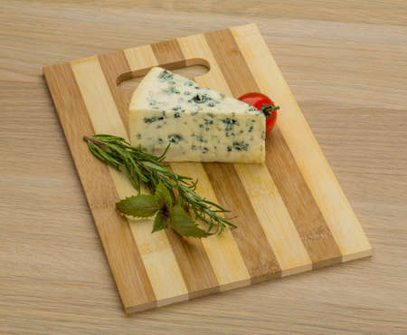 roquefort: Blue cheese with rosemary and mint on the desk Stock Photo
