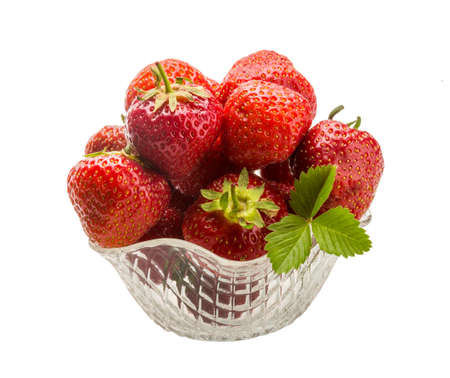 Strawberry in the bowl with leaf photo