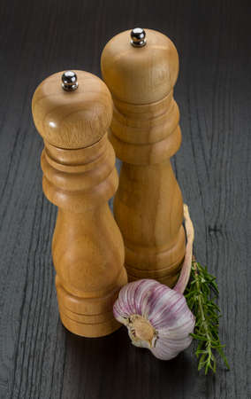 Pepper mill with garlic and rosemary photo