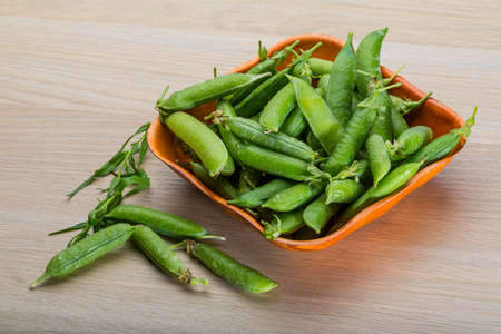 Fresh green peas in the bowl photo