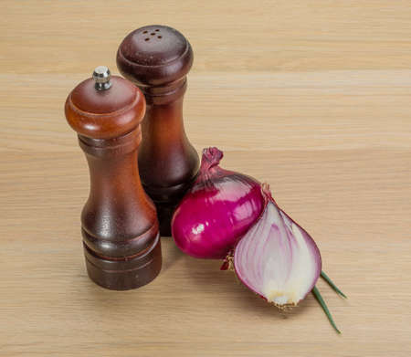 Pepper mill with onion on the desk photo