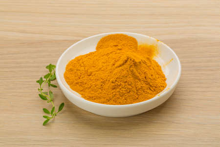 curcuma: Curcuma powder in the bowl Stock Photo