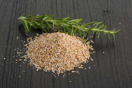 crusted: Crusted pearl barley on the board Stock Photo