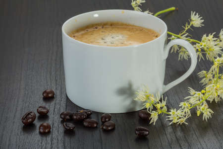 cofffee: Cup of cofffee with beans