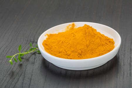 Curcuma powder in the bowl photo
