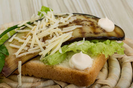 Panini with grilled eggplant, salad leaves and cheese photo