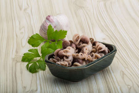 Boiled octopus - mini seafood in the bowl photo