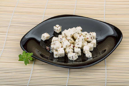 Soft cheese with spices and olive oil photo
