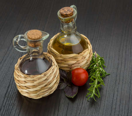 Oil, vinegar with rosemary on the desk photo