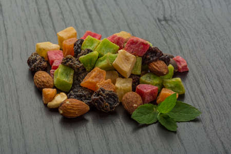 Dried fruits mix on the desk photo
