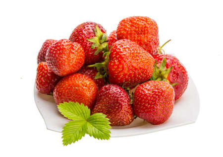 Strawberries in the bowl with leaf photo