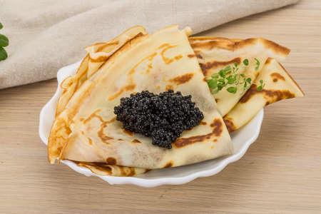 pancake week: Pancakes with black caviar - russian style breakfast Stock Photo
