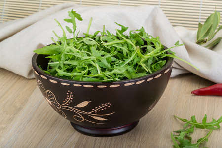 ruccola: Ruccola leaves mix in the bowl on wooden