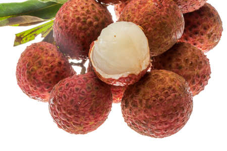 litschi: Asian fruit lychee heap isolated Stock Photo