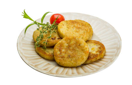 hashbrown: Hashbrowns with herbs in the plate
