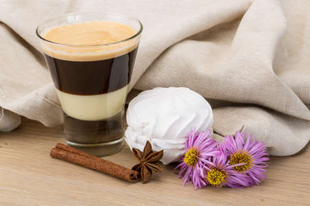 capuccino: Capuccino with zephyr and cinnamon on the wooden background Stock Photo