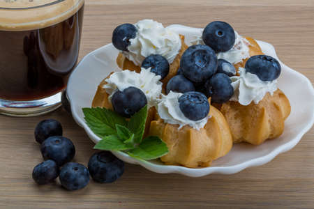 profiterole: Profiterole with blueberry and cup of coffee