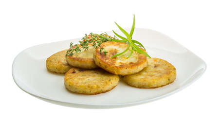 hashbrowns: Hashbrowns with herbs in the plate